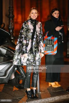 Olivia Palermo is wearing a floral print jacket black leather pants and black leather heels after the Giambattista Valli show during Paris Fashion...