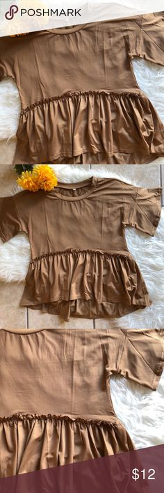 Ruffled Short Sleeve Top New without tags too with a flowy ruffled bottom and loose short sleeves. Tops Tees - Short Sleeve