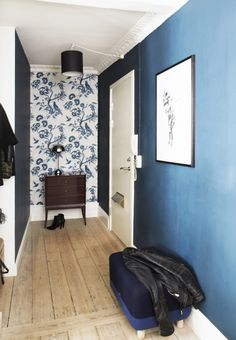 Blue hallway with wallpaper feature wall