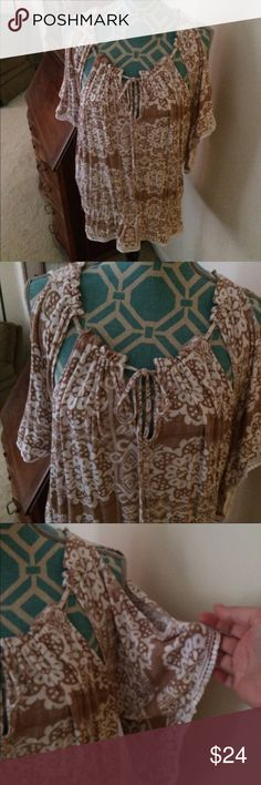Eci New York cold shoulder top Eci ny cold shoulder top . NWOT . Size XL junior. Colors- white and beige . Eye lit around the edges. Detailed. Lovely pattern. Very unique!! ECI Tops Tunics
