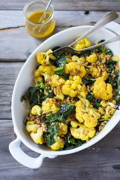 Roasted Cauliflower Salad with farro (or any cooked grain), lacinato kale and an earthy turmeric dressing. Delicious and healthy, it can be a served warm as a side
