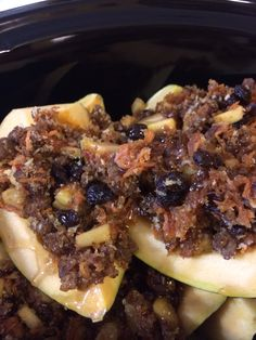 Stuffed Acorn Squash.   Sausage, apples, carrots, raisins, dates, cinnamon, butter and maple syrup.