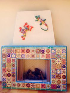 Colorful collage of mexican tile for outdoor fireplace. The lizard and frog are a great touch!