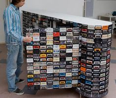 Cassettes. Spray painted some cool colors like neon or one continuous color and on a smaller scale cabinet or even the top  sliding closet door. How Fun! But where would I get cassette tapes?