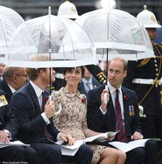 It was very much a case of teamwork on the Princes' behalf when it came to keeping the Duchess dry.