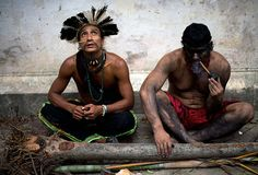 Natives living in the old indigenous museum, Aldea Maracana, take part in a demo against the governmet decision to throw them out and pull down the building, to construct 10,500 parking lots for the upcoming Brazil 2014 World Cup in Rio de Janeiro, Brazil.  Photograph: Christophe Simon