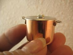 """The pots are perfect for kettles.  This is 3/4 inch but  I also used  1/2"""" for saucepans.  They are so nice and shiny!  I haven't shown it, but I painted the inside of the pot with silver nail polish.  It takes on the look of tinning; it keeps the copper from tainting the food.  I used from 2 to 4 coats of nail enamel to build up the color. Below is one of the polishes I used."""