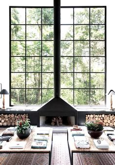 Industrial fireplace and gorgeous windows