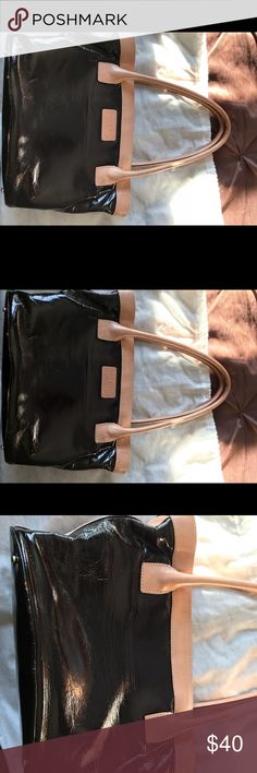 Kate spade bag Kate Spade bag, bucket style no zip. Patent brown with tan trim. Nice bag and gently used so please review pics for signs of wear. kate spade Bags Satchels