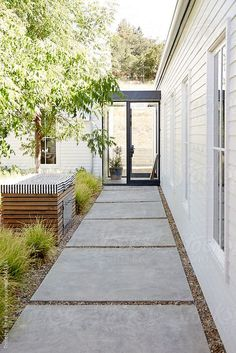 Walkway in outdoor courtyard of modern design home by trinettereed | Stocksy United Patio Central, Concrete Pathway, Large Concrete Pavers, Paver Pathway, Outdoor Walkway, Cement Patio, Outdoor Tiles, Cement Tiles, Cement Driveway