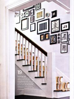 I like the arrangement of the frames. They are very interesting. It would be a great idea for our house since you walk into the house and the stairs are the first thing you see.