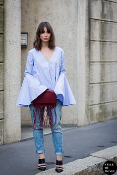bell sleeved top with jeans and fringe bag