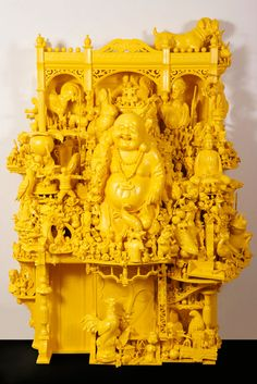 Sculptures by Rondle Royce  Assemblage sculpture using icons from pop culture, science fiction, technology, and religion. The bold and colorful works resemble the sculptures of Ganesha in Indian culture.