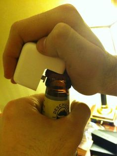 Apple Power adapter as beer opener. Ultimate Geek Macgyver Tip!