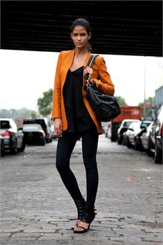 NYFW simple, polished style. love the pop of orange in the blazer.