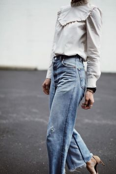 High waisted blue jeans with a grey blouse and high heels @coveteur