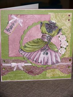 Vintage card made with a Kanban stamped image, distress ink, altered lace, mulberry paper roses, ribbons and K and Company papers.