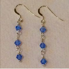 Blue Swarovski crystal earrings These are beautiful blue Swarovski glass crystal earrings with 925 Sterling silver ear wires. They hang down about 1 1/4 inches. Handmade by me. NWOT Jewelry Earrings
