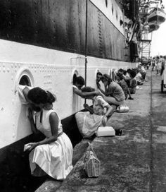 Soldiers kissing their girlfriends before heading to the WWII battlefields, 1940.