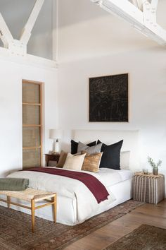 California bedroom design with black painting above bed and vintage kilim textiles and pouf designed by Amber Interiors on Thou Swell Home Bedroom, Modern Bedroom, Bedroom Decor, Bedrooms, Casual Bedroom, Bedroom Lighting, Design Bedroom, Bedroom Ideas, Master Bedroom