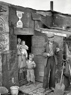 "January 1939. ""Herrin, Illinois. Family on relief living in shanty at city dump."" Photo by Arthur Rothstein for the Resettlement Administration."