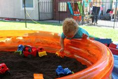 fill a swimming pool with dirt and add some toy trucks for a construction themed birthday party