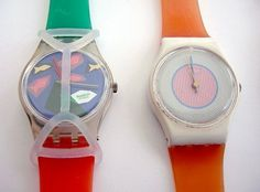 swatch with & without watch guard.  I liked the old guards better.  I still have my swatch - but the kids have lost the guard.