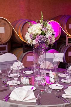Winery wedding reception, with radiant orchid accents. Roses, hydrangea, mums, wax, lisianthus, seeded euc, crystals