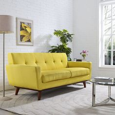 Engage Upholstered Loveseat, Sunny - Gently sloping curves and large dual cushions create a favorite lounging spot. Whether plopping down after a long day at work, settling in with coffee and brunch, or entering a spirited discussion with friends, the Engage loveseat is a welcome presence in your home. Five tufted buttons create eye catching appeal; adding depth that brings your sitting decor to center stage. Four cherry color rubber wood legs and frame supply a solid base to the comfortable…