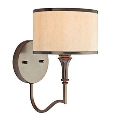 Oiled bronze-finished wall sconce with a curved silhouette and drum shade.     Product: Wall sconce  Construction Mat...