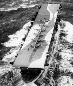 An aerial view of the Royal Navy's aircraft carrier the HMS Avenger with Sea Hurricanes on deck