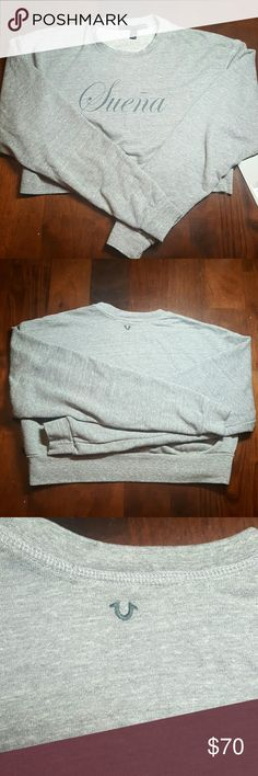 Joan Smalls X True Religion half sweat shirt LG Joan Smalls X True Religion Gray half Sweat Shirt with Suena across the front perfect for looking cute while working out or just standing around. This is the go to sweat shirt for  EVERY season. Gray LG True Religion Tops Sweatshirts & Hoodies