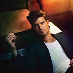 Robin Thicke! Not only can the man sing, but he is damn good lookin'!