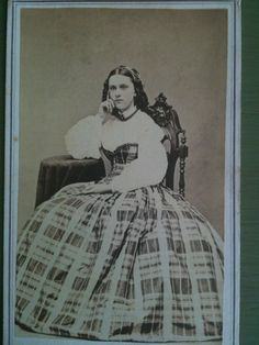 Young 1860s lady wearing swiss waist and skirt. American