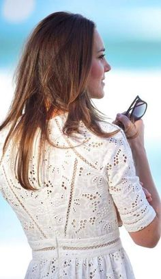 """Catherine, Duchess of Cambridge, aka Kate Middleton, at the final stop for the day the famous Manly Beach, Sydney, Australia. Kate is wearing a broderie anglaise """"Roamer Day Dress"""" from Zimmermann, Natalie clutch from LK Bennett, Stuart Weitzman Minx Espadrille Wedges, and her Cartier Wristwatch from the Ballon de Bleu collection. 4/18/14"""