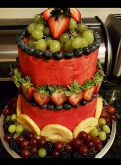 Fruit Cake Watermelon base with pineapple, strawberry, red seedless grapes, blueberry, & blackberry trim