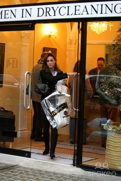 Kate Middleton girlfriend of Prince William of Wales visits a dry cleaners