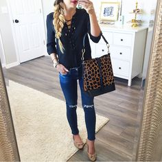 Lace up top and leopard bag