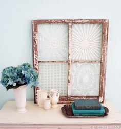 Vintage window Frames with lace doilies being used as wall art - 15 Fascinating Crafts With Lace Doilies You Should Make Immediately!