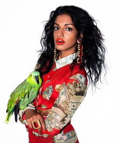 Superstar M.I.A. wearing serious baubles on the cover of Paper Mag's newest issue.