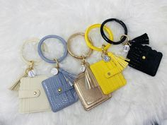 """These PU leather ID holder key rings come with matching tassel and with 4 """" ID holder in the same color. These make a stylish and useful gift to give or for yourself! 🌻 If you chose to add a monogram, please enter your initials as you wanted in the personalization. 🌻 PU (faux) leather key ring Leather Keyring, Id Wallet, Id Holder, Key Rings, Cosmetic Bag, Pu Leather, Personalized Gifts, Gifts For Her, Best Gifts"""