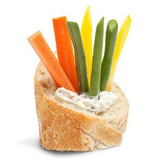 For an easy, healthy afternoon snack, form a well in a slice of baguette and fill it with a dollop of dip and plenty of veggie sticks.