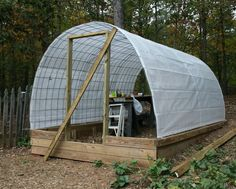 """Cattle panel hoop house on raised wood foundation, that's the way to go for raising the interior ceiling. """"Building a permanent greenhouse with cattle panels - part 1 - HOMEGROWN"""" Greenhouse Supplies, Build A Greenhouse, Greenhouse Growing, Greenhouse Ideas, Greenhouse Wedding, Cheap Greenhouse, Greenhouse Gardening, Homemade Greenhouse, Greenhouse Film"""