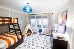 Love the way our Kartell FLY Suspension looks in this kids' room makeover!