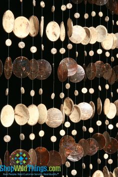 Wow! This wonderful beaded curtain is made out of hundreds of coconut shell pieces and mocha colored real capiz shells. You will love the gentle sound that they make as they swing in the breeze. Meas