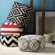 Make your own West Elm floor poufs from $3 IKEA rugs. | 35 Money-Saving Home Decor Knock-Offs - and 34 other money saving knock offs
