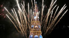 RIO DE JANEIRO, BRAZIL  Fireworks explode near a traditional Rio de Janeiro Christmas tree during the official lighting ceremony at Rodrigo de Freitas Lake. In Brazil, Santa Claus is called Papai Noel. Favorite holiday foods include chicken, turkey, ham, rice, pork, and fresh and dried fruits.