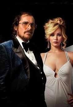American Hustle (2013) Directed by David O. Russell. Irving Rosenfeld (Christian Bale) & Rosalyn Rosenfeld (Jennifer Lawrence).