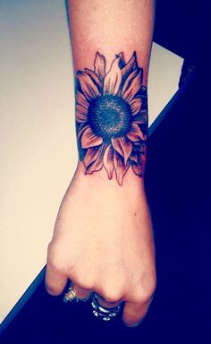 Awesome Sunflower Tattoos on Inner Wrist