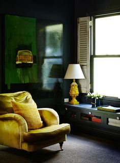 great colors - yellow chair and lamp, black walls, dark green canvas